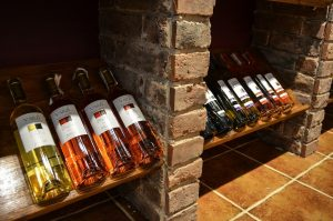wine bottles on old fashioned racks - featured image